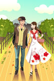 Couple walking in a winery Royalty Free Stock Image