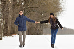 Couple walking in winter park Stock Photography