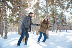 Couple walking in the winter park Royalty Free Stock Image