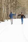 Couple walking in winter park Royalty Free Stock Photo