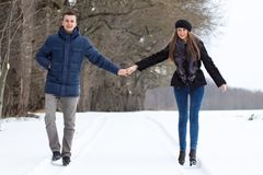 Couple walking in winter park Stock Photos