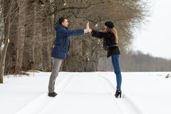 Couple walking in winter park Royalty Free Stock Image