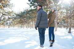 Couple walking in winter park Stock Images