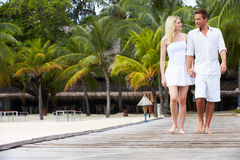 Couple Walking On Wooden Jetty Royalty Free Stock Photo