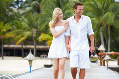Couple Walking On Wooden Jetty Stock Photos