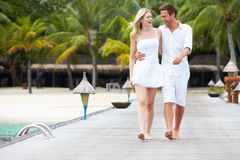 Couple Walking On Wooden Jetty Stock Image