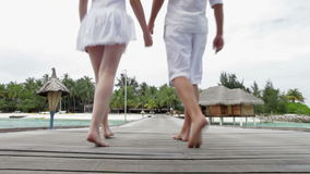 Couple Walking On Wooden Jetty Royalty Free Stock Image
