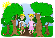 A couple walking through the woods Royalty Free Stock Image