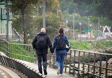 Couple Walks Along Boardwalk royalty free stock photography