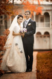 Couple walks in beautiful autumn park Stock Photography