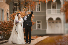 Couple walks in beautiful autumn park Royalty Free Stock Images