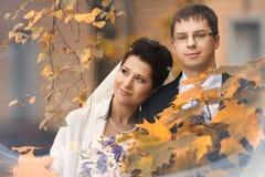 Couple walks in beautiful autumn park Stock Image