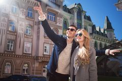 Couple walks in the beautiful city, bright day stock photos