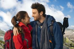 Couple in warm clothes trekking Stock Photo