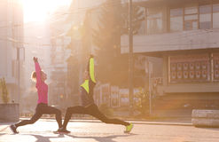 Couple warming up before jogging Royalty Free Stock Images