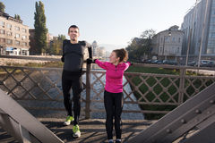 Couple warming up before jogging Royalty Free Stock Photo