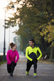 Couple warming up before jogging Royalty Free Stock Image