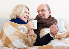 Couple warming up with tea Stock Photos
