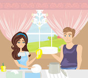 Couple washing dishes in the kitchen Royalty Free Stock Photography