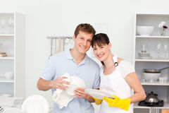 Couple washing dishes together Royalty Free Stock Photos