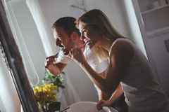Couple washing teeth in morning Stock Images