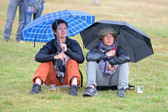 A couple watches a concert under the rain at Heineken Primavera Sound 2014 Festival Royalty Free Stock Images