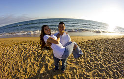 Couple watchign the sunset at the beach stock photo