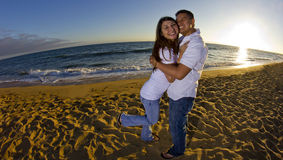 Couple watchign the sunset at the beach royalty free stock images