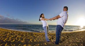 Couple watchign the sunset at the beach royalty free stock photography