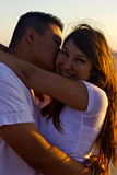Couple watchign the sunset at the beach stock photos
