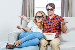 Couple watching a 3D movie. In the living room Royalty Free Stock Image