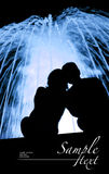 Couple watching fountain. Rear view of silhouetted couple watching illuminated fountain at night. Space for text isolated on black Royalty Free Stock Photo