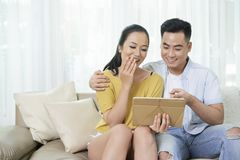 Couple watching funny videos stock photos