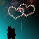 Couple watching heart firework Stock Image