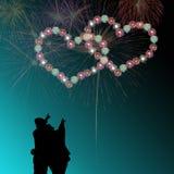 Couple watching heart firework Stock Image