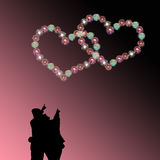 Couple watching heart firework Stock Images