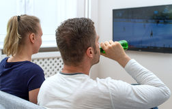 Couple watching hockey. Royalty Free Stock Images