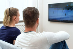Couple watching hockey. Royalty Free Stock Photos