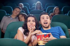 Couple watching horror movie. Stock Photo