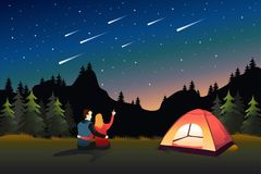Couple Watching Meteor Shower While Camping Stock Photo