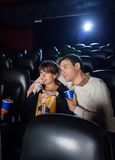 Couple Watching Movie In Cinema Theater Stock Photo