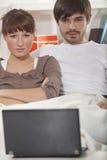 Couple watching movie on laptop Stock Image