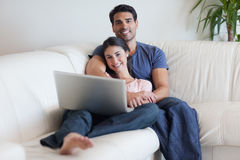 Couple watching a movie with a laptop Stock Photography