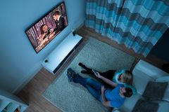 Couple watching movie in living room Royalty Free Stock Images