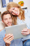 Couple watching movie stream on Royalty Free Stock Photography