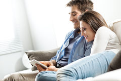 Couple watching movie on tablet Stock Photo