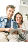 Couple watching movie on tablet Stock Image