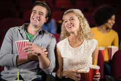 Couple watching movie in theatre. Happy couple watching movie in theatre Stock Image