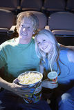 Couple Watching Movie Together In Theatre Stock Photo