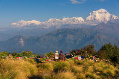 Couple watching the Mt. Dhaulagiri 8,172m from Poonhill, Nepal. Royalty Free Stock Photo